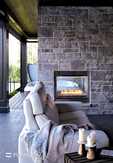 Welcoming space featuring an interior stone wall