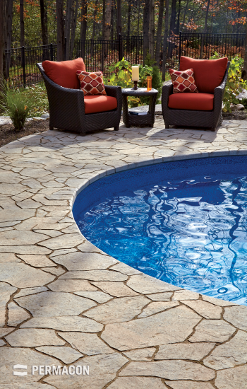 A relaxation area enhanced with a poolside with a natural stone slab effect