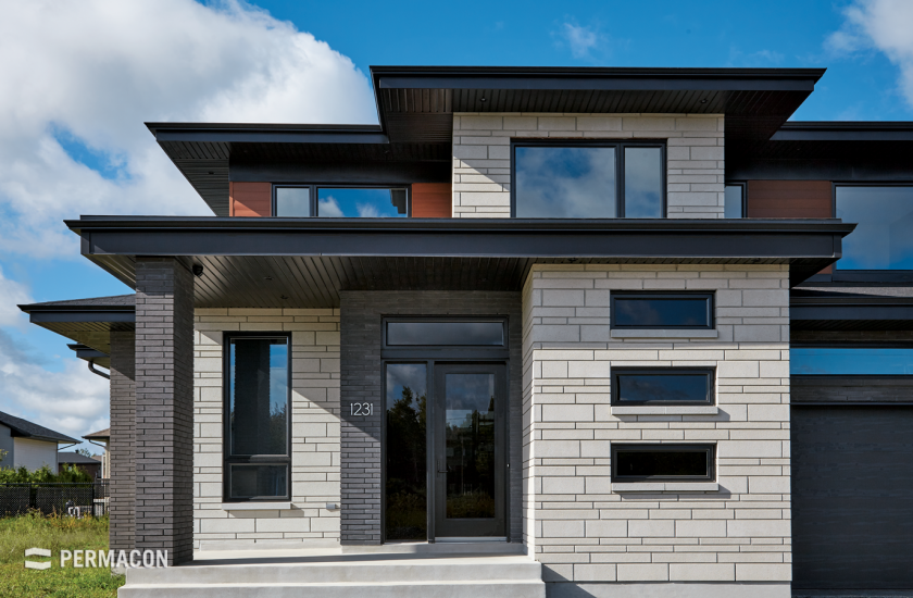 Contrasting stone and brick residence