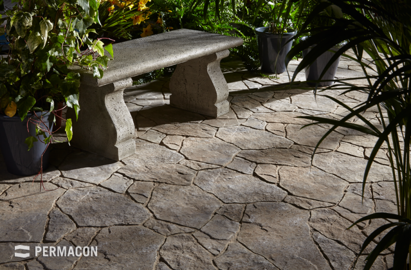 Quaint secret garden created with natural-looking stone slabs