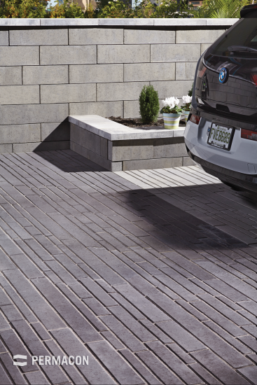 These uniquely designed pavers and wall give your driveway a contemporary look