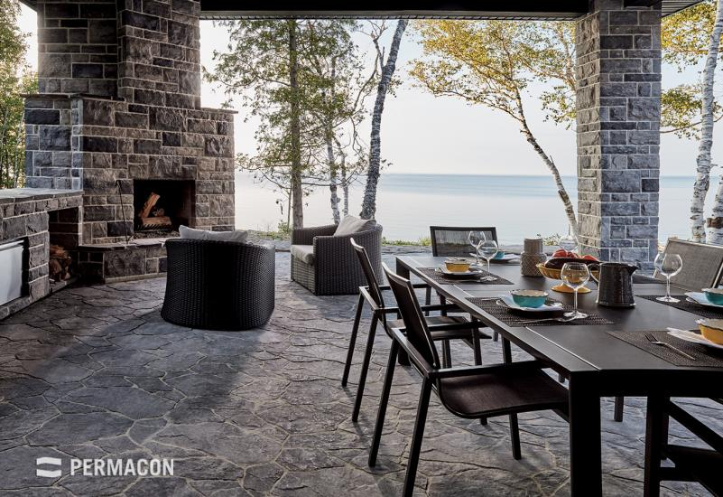 Exterior fire pit and a patio with a roof